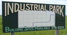 Industrial park building sites available 378-2231 sign